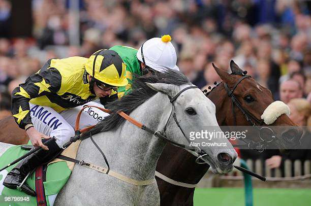 Strawberrydaiquiri and Ryan Moore win The Stanjamescom Dahlia Stakes from Honimiere at Newmarket racecourse on May 02 2010 in Newmarket England