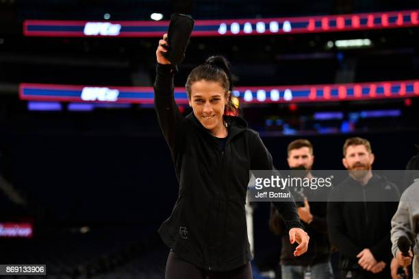Strawweight Champion Joanna Jedrzejczyk interacts with fans and media inside Madison Square Garden on November 1, 2017 in New York City.