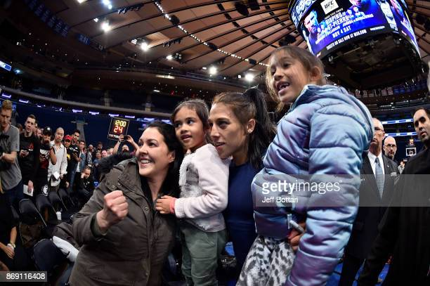 Strawweight Champion Joanna Jedrzejczyk of Poland poses with fans inside Madison Square Garden on November 1 2017 in New York City