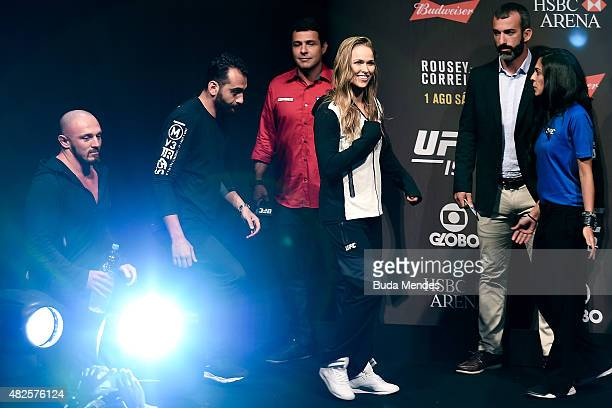 Strawweight Champion Ronda Rousey of the United States prepares to step onto the scale during the UFC 190 Rousey v Correia weigh-in at HSBC Arena on...