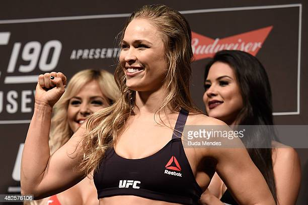 Strawweight Champion Ronda Rousey of the United States steps onto the scale during the UFC 190 Rousey v Correia weigh-in at HSBC Arena on July 31,...