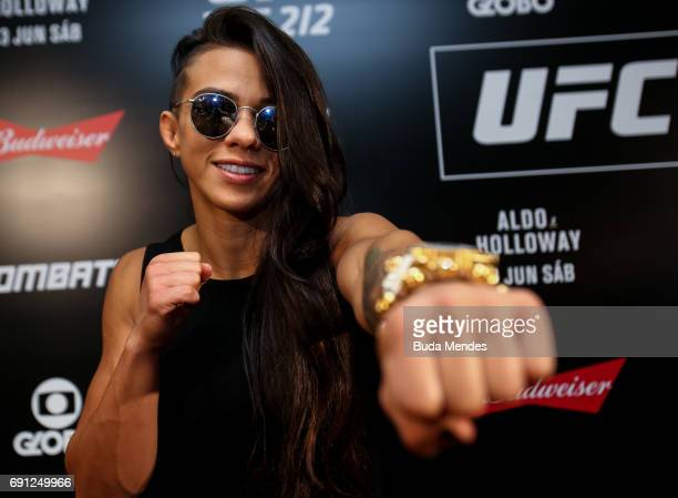 UFC strawweight contender Claudia Gadelha of Brazil pose for photographers during Ultimate Media Day at Windsor Hotel on June 01 2017 in Rio de...
