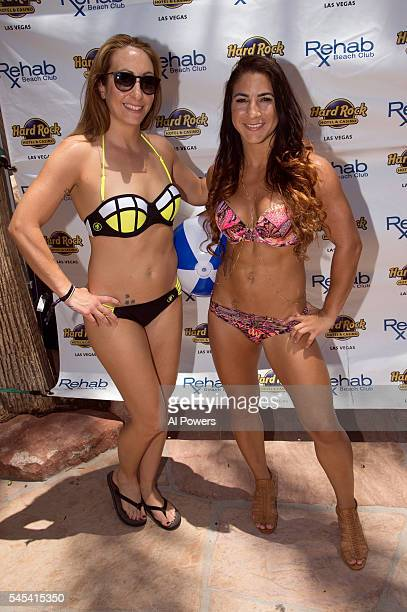 UFC strawweight contenders Heather Jo Clark and Tecia Torres pose for a photo during the UFC International Fight Week Pool Party at Rehab at the Hard...