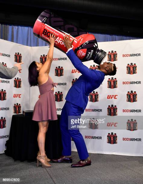 UFC strawweight Cynthia Calvillo and UFC heavyweight Francis Ngannou have fun onstage during the UFC BodyArmor partnership announcement inside...