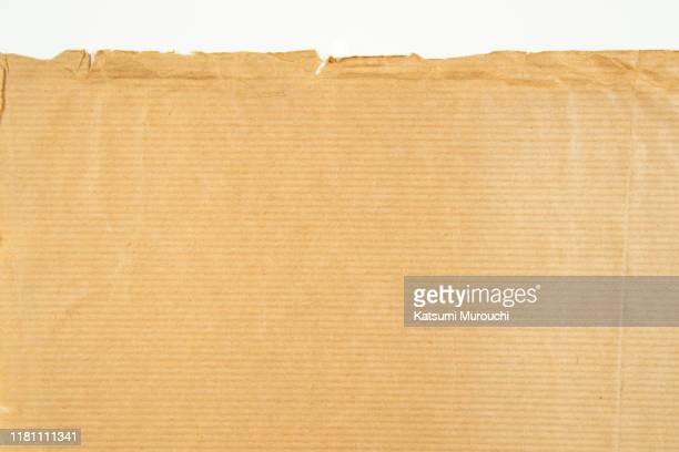 streaked kraft paper texture background and torn edge - brown paper stock pictures, royalty-free photos & images