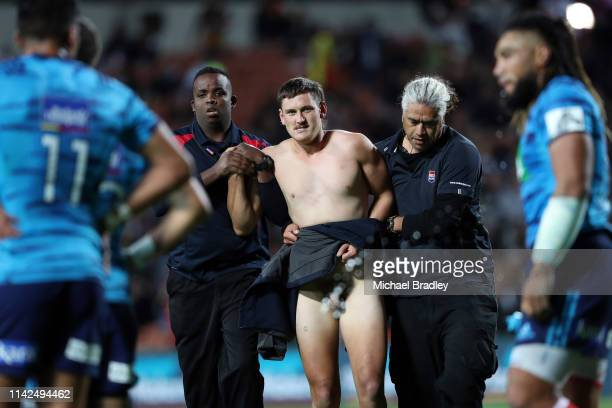 A streaker delays play during the round 9 Super Rugby match between the Chiefs and the Blues at FMG Stadium on April 13 2019 in Hamilton New Zealand