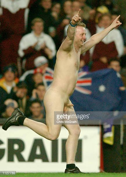 A streaker disrupts play during the Rugby League Test match between the Australian Kangaroos and the Great Britain and Irish Lions held at Aussie...