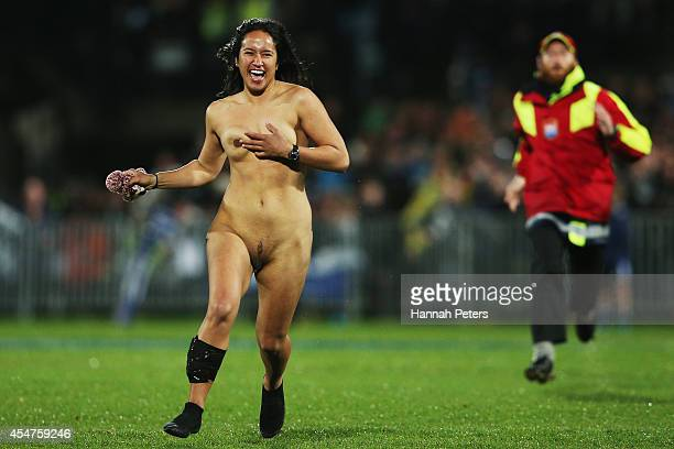 A streaker enters the field during The Rugby Championship match between the New Zealand All Blacks and Argentina at McLean Park on September 6 2014...