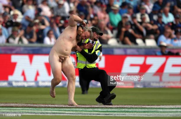 Image contain nudity A streaker enters the field of play during the ICC Cricket World Cup 2019 match between England and New Zealand at Emirates...