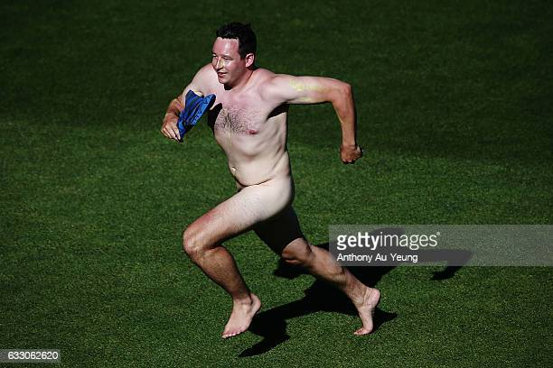 A streaker evades the field during the first One Day International game between New Zealand and Australia at Eden Park on January 30 2017 in Auckland...