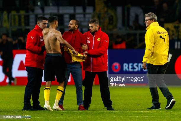 A streaker gets the jersey from Achraf Hakimi of Borussia Dortmund during the UEFA Champions League Group A match between Borussia Dortmund and Club...