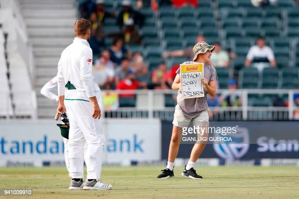 A streaker invades the field of play on the fourth day of the fourth Test cricket match between South Africa and Australia won by South Africa at...