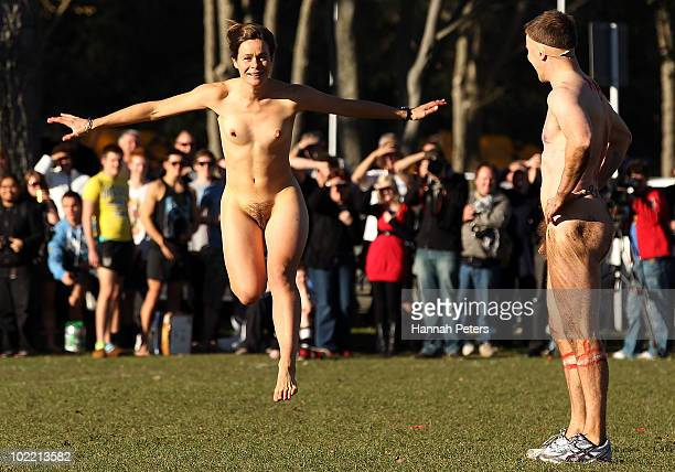 A streaker invades the pitch during a nude rugby game at Logan Park on June 19 2010 in Dunedin New Zealand A naked rugby match is a traditional...