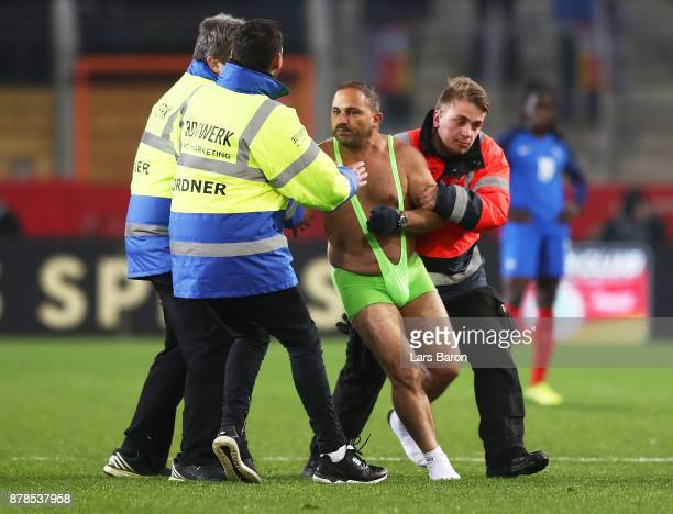 A streaker invades the pitch during the Germany v France Women's International Friendly match at Schueco Arena on November 24 2017 in Bielefeld...
