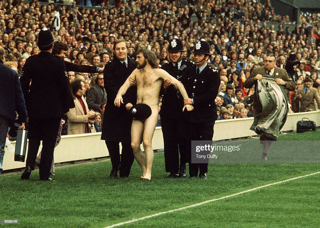 A streaker is arrested during the Five Nations match between England and Wales, in 1976, at Twickenham in London.