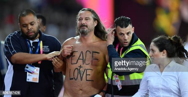 A streaker is being escorted from the track before the men's 100m final during the IAAF Athletics World Championships London 2017 at London Stadium...