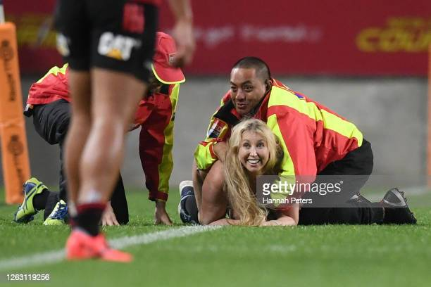 Streaker is caught by security during the round 8 Super Rugby Aotearoa match between the Chiefs and the Crusaders at FMG Stadium Waikato on August...