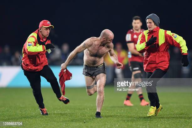 Streaker is chased by security during the round 5 Super Rugby Aotearoa match between the Crusaders and the Blues at Orangetheory Stadium on July 11,...