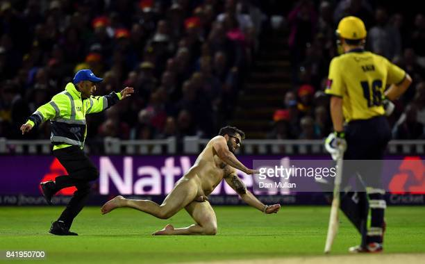 A streaker is detained by a steward during the NatWest T20 Blast Final between Birmingham Bears and Notts Outlaws at Edgbaston on September 2 2017 in...