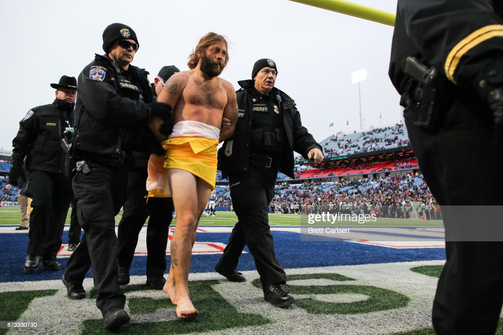 A streaker is escorted off the field during the fourth quarter between the Buffalo Bills and New Orleans Saints on November 12, 2017 at New Era Field in Orchard Park, New York.