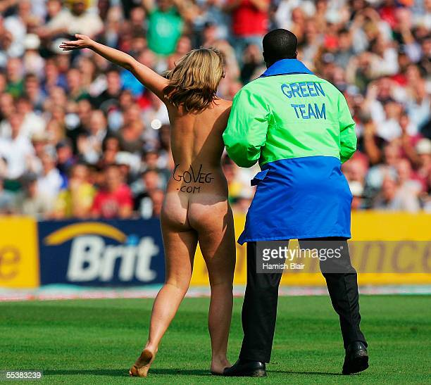 A streaker is led away by security during day five of the Fifth npower Ashes Test between England and Australia played at The Brit Oval on September...
