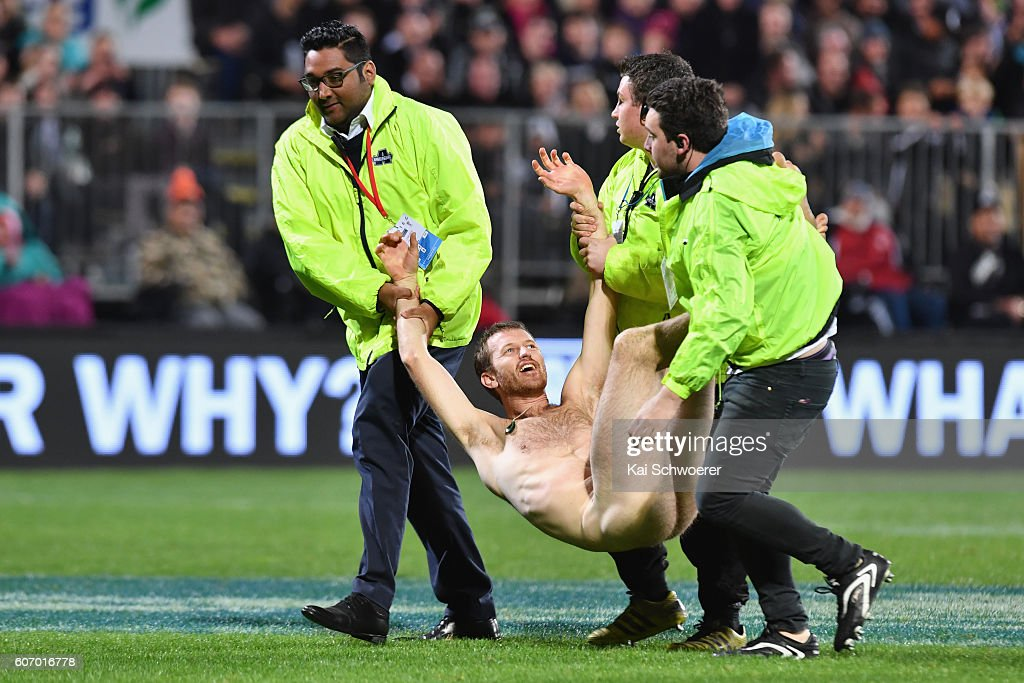 A streaker is led off the playing field by security staff during the Rugby Championship match between the New Zealand All Blacks and the South Africa Springboks at AMI Stadium on September 17, 2016 in Christchurch, New Zealand.