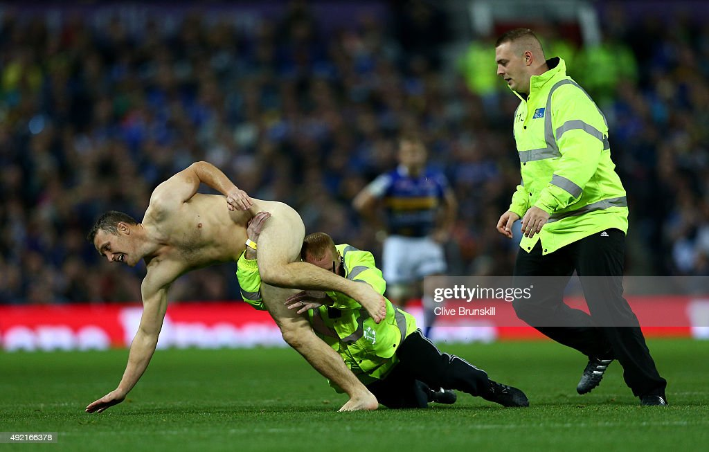 A streaker is tackled by a steward during the First Utility Super League Grand Final between Wigan Warriors and Leeds Rhinos at Old Trafford on October 10, 2015 in Manchester, England.