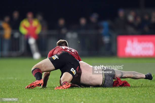 A streaker is tackled by Braydon Ennor of the Crusaders during the round 5 Super Rugby Aotearoa match between the Crusaders and the Blues at...