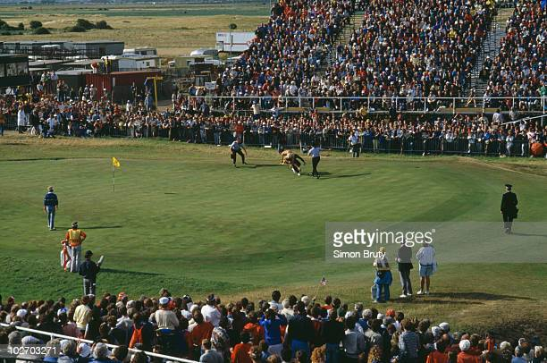 A streaker is tackled by police on the 18th green during the British Open on 21 July 1985 at the Royal St George's Golf Club in Sandwich Kent England