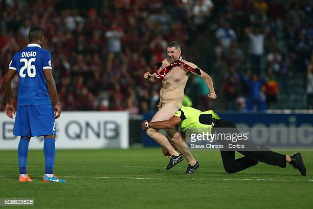 A streaker is tackled by security during the final stages of the Wanderers and AlHilal AFC Champions League Final at Parramatta Stadium Sydney...