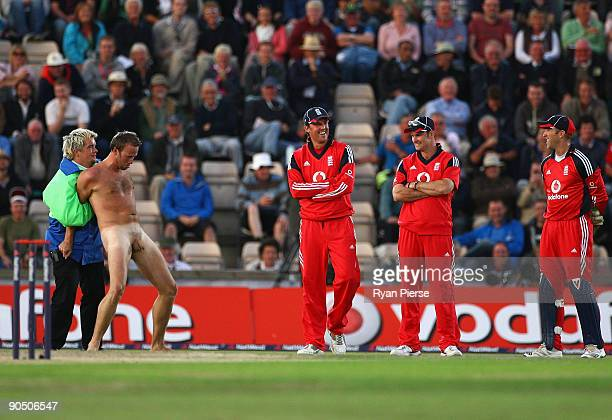 A streaker is tackled by sercurity as England players look on during the 3rd NatWest One Day International between England and Australia at the Rose...