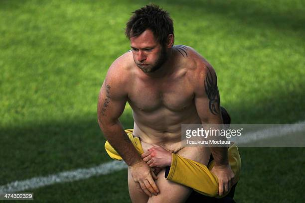 A streaker is tackled during the NRL trial match between the Brisbane Broncos and the New Zealand Warriors at Forsyth Barr Stadium on February 23...