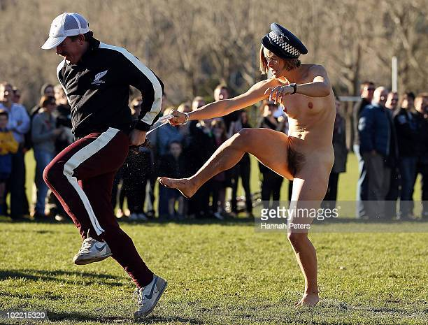 A streaker is taken off the field during a nude rugby game at Logan Park on June 19 2010 in Dunedin New Zealand A naked rugby match is a traditional...