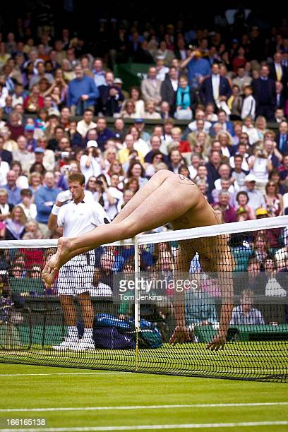 A streaker jumps over the net on Centre Court during the men's singles final between David Nalbandian and Lleyton Hewitt at Wimbledon on July 7th...
