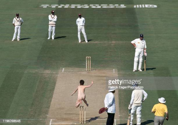 Streaker leaps over the wicket interrupting play during the 2nd Test match between England and West Indies at Lord's Cricket Ground, London, 25th...