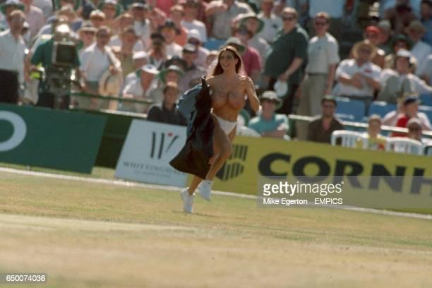 A streaker Linsey Dawn Mckenzie runs on the field in Manchester