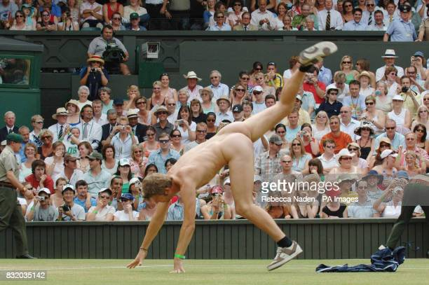A streaker peforms a cartwheel on the Centre Court at Wimbledon during the quarterfinal match between Russians Maria Sharapova and Elena Dementieva