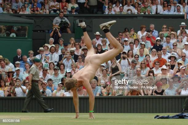 A streaker performs a cartwheel on the Centre Court at Wimbledon during the quarterfinal match between Russians Maria Sharapova and Elena Dementieva