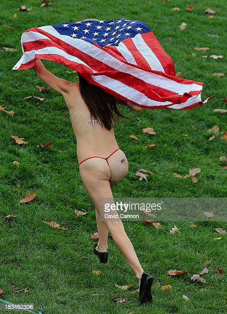 A streaker runs on the 18th hole during the Day Four Singles Matches at the Muirfield Village Golf Club on October 6 2013 in Dublin Ohio
