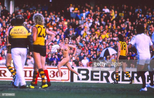 A streaker runs onto the field during the VFL Grand Final between Hawthorn Hawks and Melbourne Demons on September 24 1988 at the MCG in Melbourne...