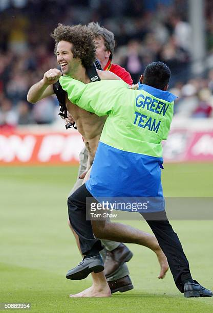 A streaker runs onto the pitch during the fourth day of the first npower test match between England and New Zealand at Lord's Cricket Ground on May...