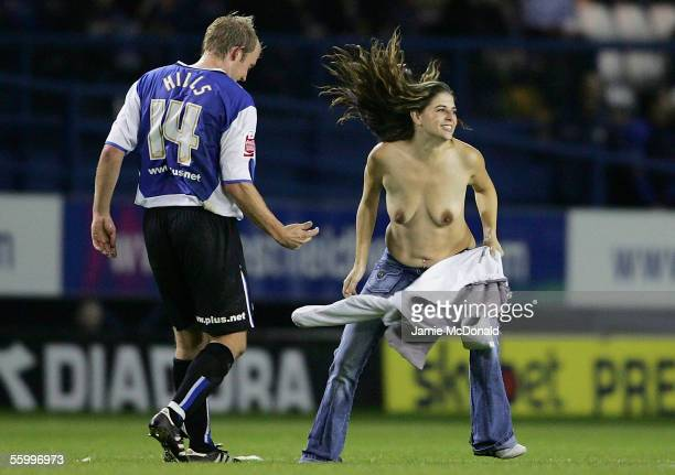 A streaker runs onto the pitch next to John Hills of Sheffield during the CocaCola Championship match between Sheffield Wednesday and Brighton and...