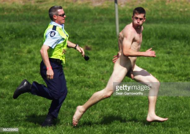 A streaker runs onto the track after the running of the Melbourne Cup at Flemington Racecourse November 1 2005 in Melbourne Australia