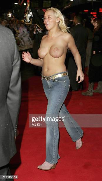 A streaker runs out of the crowd at the UK Premiere of 'Be Cool' at the Empire Leicester Square on March 7 2005 in London The film is the followup to...