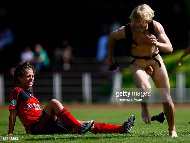 A streaker runs to Vanessa Wurth of Leverkusen during the Women's 2 Bundesliga match between Bayer 04 Leverkusen and 1 FC Saarbruecken at the...