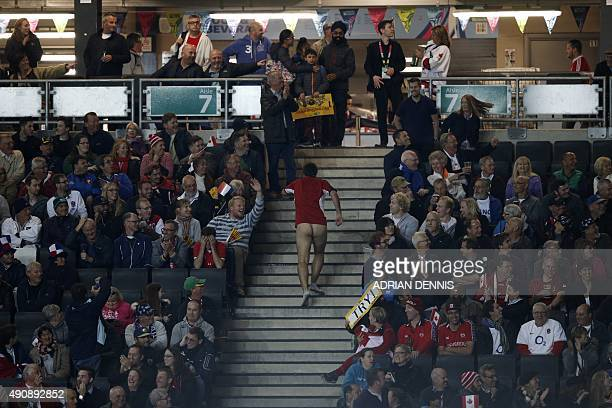 Streaker runs up stairs after going on the pitch during a Pool D match of the 2015 Rugby World Cup between France and Canada at Stadium MK in Milton...