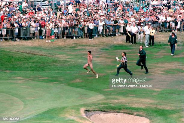 Streaker runs up the 18th fairway at the Royal Lytham and St Annes golf course