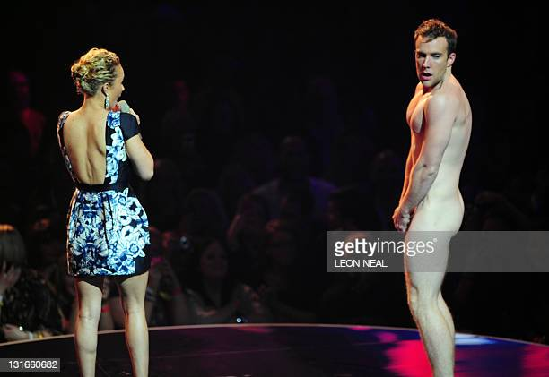 A streaker stands on stage with presenter US singer Selena Gomez at the MTV European Music Awards at the Odyssey Arena in Belfast Northern Ireland on...