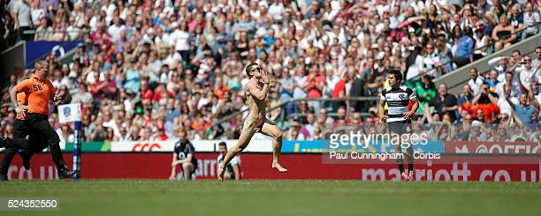 A streaker takes to the field chased by security officials during the England vs Barbarians match at Twickenham Stadium London 26 May 2013 Image by...