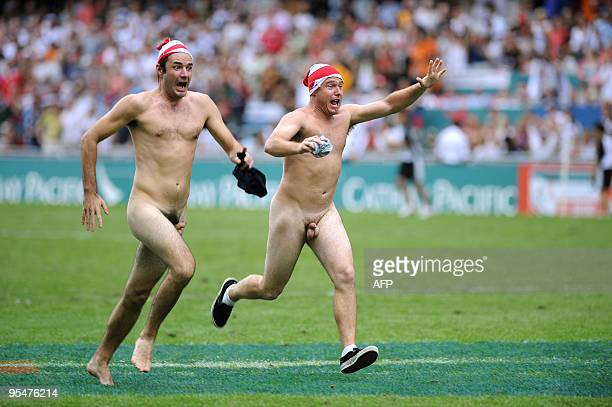 Streakers run across the pitch at the Hong Kong Rugby Sevens tournament on March 29 2008 The tournament is the fifth event of the 200708 IRB Sevens...
